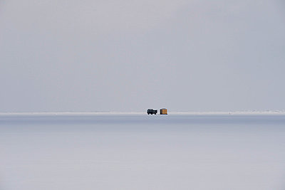 Russia, Lake Baikal, pickup truck on frozen lake beside hut for ice fishing - p300m1053170f by Gerald Nowak