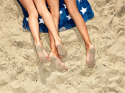 Girls lying at the beach - p4297459f by jf