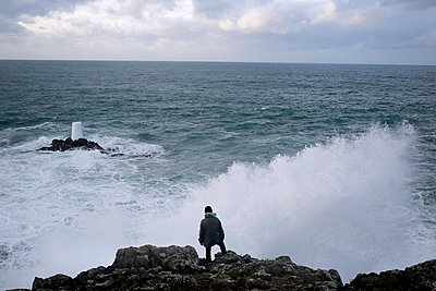 Man facing Sea Wave  - p1307m2222442 by Agnès Deschamps