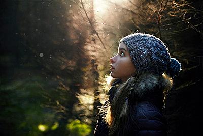 Profile of Caucasian teenage girl in forest - p555m1219683 by Vladimir Serov