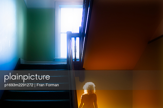 Woman on the stairs - p1693m2291272 by Fran Forman