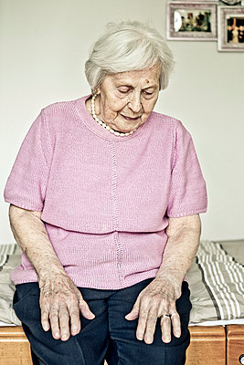 Old woman is sitting on her bed - p1221m1176714 by Frank Lothar Lange