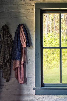 Coats Hanging by Window - p1331m1195738 by Margie Hurwich