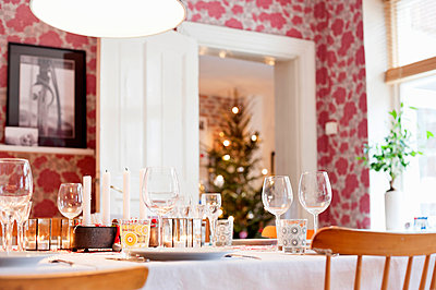 Table set for Christmas meal - p312m1113980f by Rebecca Wallin