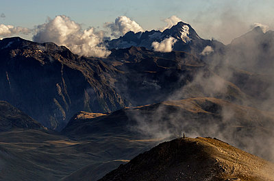Plateau d'Emparis mountain range in the fog - p910m1159404 by Philippe Lesprit