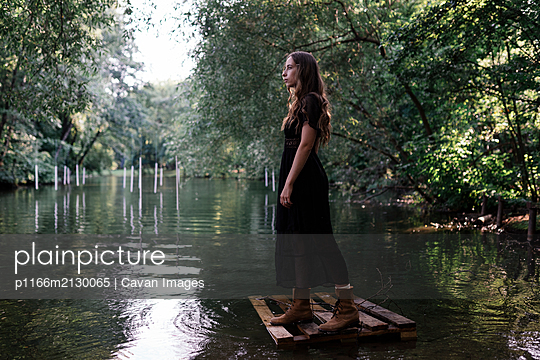 woman on the nature near the river - p1166m2130065 by Cavan Images
