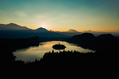 Early morning sunrise at Lake Bled - p1455m2043703 by Ingmar Wein