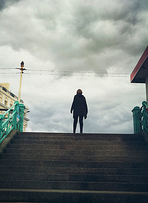 Teenager on steps - p984m1172290 by Mark Owen
