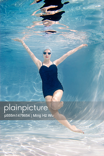 Caucasian woman swimming underwater