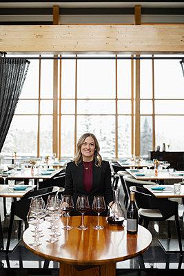 Portrait smiling, confident female sommelier ready for wine tasting in restaurant - p1192m2047416 by Hero Images