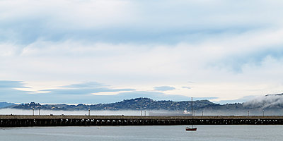 A sailboat on San Francisco Bay. - p343m1554732 by Ron Koeberer
