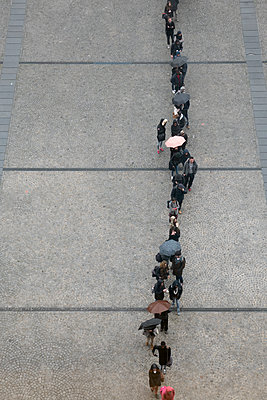 Queue of People  - p1490m1578302 by Michael Malyszko