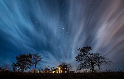 Dramatic night exposure over country farmhouse - p343m1520689 by Dave Brosha Photography