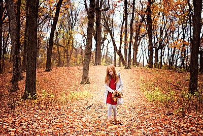 Young Red Hair Girl Playing Outside in Fall Leaves - p1166m2147051 by Cavan Images