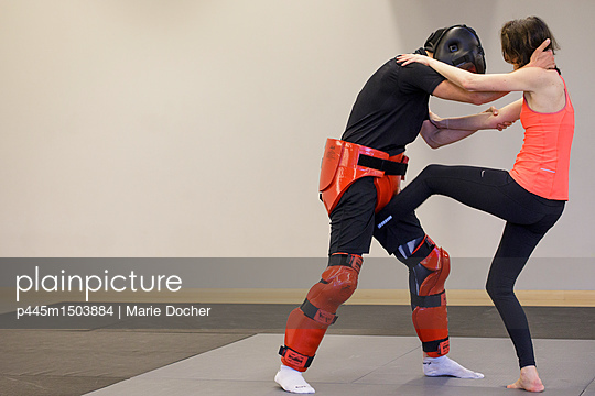 Woman training for self defense - p445m1503884 by Marie Docher
