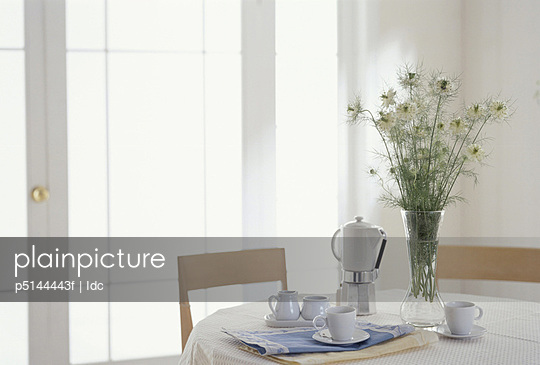Coffee on table with white flowers