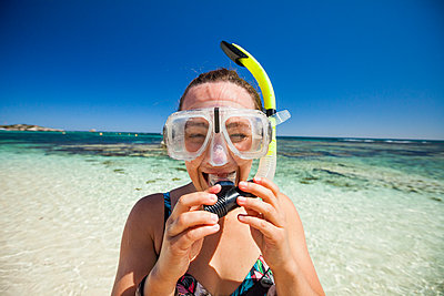 Woman wearing snorkel and swimming goggles, Perth, Western Australia, Australia - p1166m2202079 by Christopher Kimmel / Alpine Edge Photography