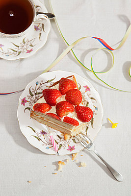 Slice of birthday cake with tea - p429m711672f by Anouk de Maar