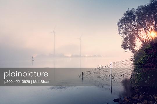 Germany, Hamburg, wind wheels across the river, morning fog - p300m2213828 by Mel Stuart
