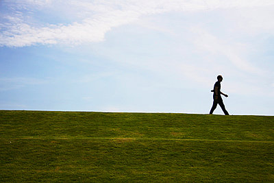Man walking straight ahead - p7950040 by JanJasperKlein