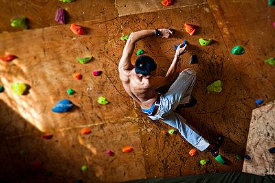 Young vietnamese in Vietclimb; a climbing room in Hanoi; Vietnam; Asia - p9340321 by Dominic Blewett