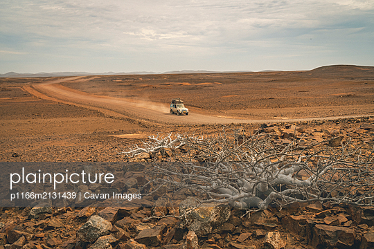 Driving Off-Road Deep in Namib Desert - p1166m2131439 by Cavan Images