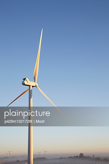 Wind turbine against blue sky - p429m1021728f by Moof