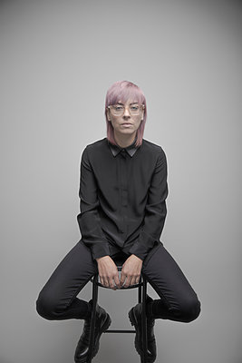 Portrait confident beautiful non-binary gender person with pink hair - p1192m2066221 by Hero Images