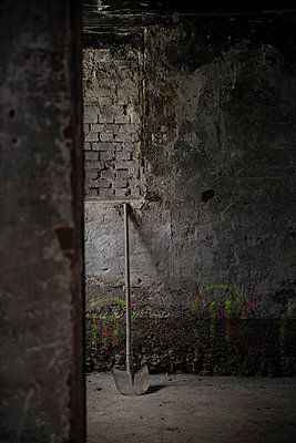 Shovel in a cellar - p335m1041645 by Andreas Körner