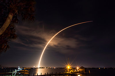 A rocket launches from Cape Canaveral,  carrying a communications satellite, over the Indian River Lagoon from Rockledge, Florida - p429m1447855 by Chris Kridler