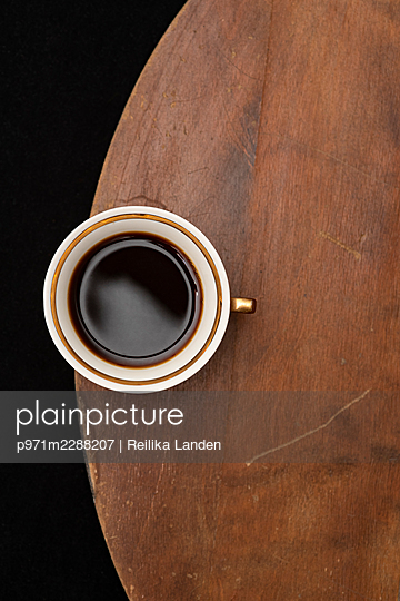 Cup of coffee on table - p971m2288207 by Reilika Landen