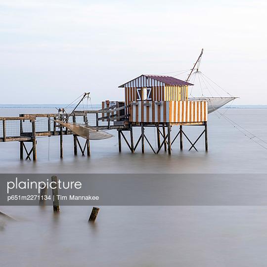 France, Nouvelle-Aquitaine, Gironde, Medoc, Saint-Estephe, a stilt fishing hut (Carrelet) on the Gironde Estuary - p651m2271134 by Tim Mannakee