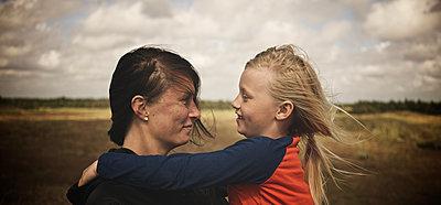 Mother and daughter together - p312m1121542f by Henrik Kindgren
