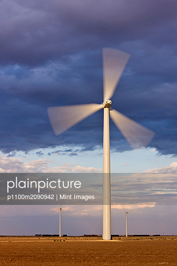 Wind Turbine Spinning at Dusk - p1100m2090942 by Mint Images