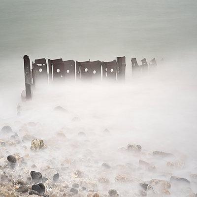 Wave-breakers in the fog - p1137m1154995 by Yann Grancher
