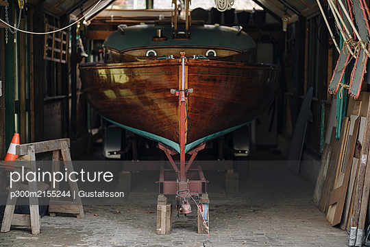 Wooden boat in a boathouse - p300m2155244 by Gustafsson