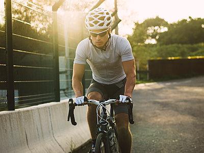 Racing biker at backlight - p300m1023244f by Ramon Espelt
