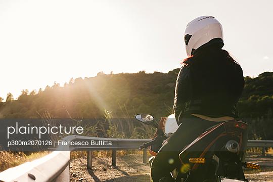 Italy, Elba Island, female motorcyclist at viewpoint - p300m2070126 by Francesco Buttitta