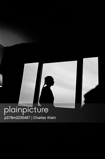Silhouette of woman - p378m2235487 by Charles Klein