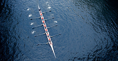 High angle view of Eight rowing on river. - p1100m1570944 by Mint Images