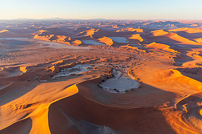 Africa, Namibia, Namib desert, Namib-Naukluft National Park, Aerial view of desert dunes, Nara Vlei and Sossus Vlei and 'Big Mama', Dead Vlei and 'Big Daddy' in the morning light - p300m2024236 by Fotofeeling
