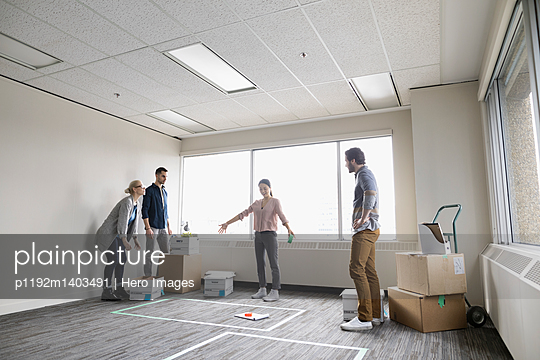 Business people measuring and planning new office space