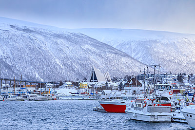 Tromso, small boat harbour, fjord, bridge, Arctic Cathedral, after heavy snow in winter, Troms, Arctic Circle, North Norway, Scandinavia - p871m2151749 by Eleanor Scriven