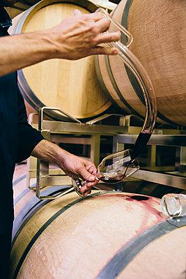 Caucasian man tasting wine - p555m1415550 by Inti St Clair
