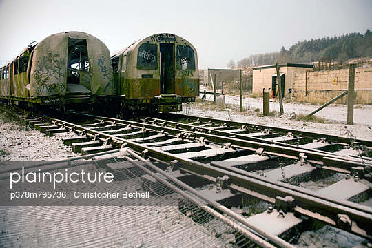 Twin trains in snow - p378m795736 by Christopher Bethell