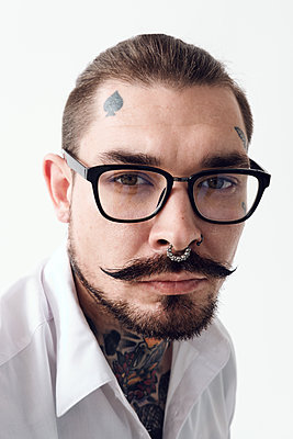 Portrait of stylish tattoo master - p1166m2148824 by Cavan Images