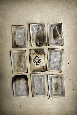 Burnt playing cards - p1228m1152388 by Benjamin Harte