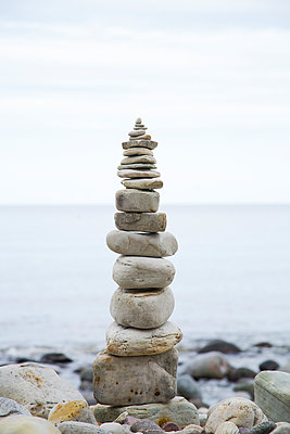 Stack of stones on beach - p312m1070527f by Hans Bjurling