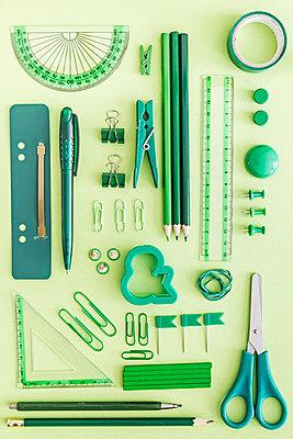 Green office supplies on green background - p300m1059240f by Melanie Kintz