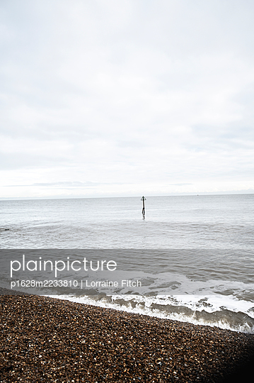 Winter Sunday on the beach - p1628m2233810 by Lorraine Fitch